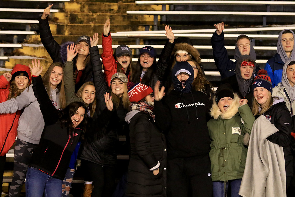 . North Middlesex Regional High School visited the Fitchburg on Wednesday night, November 21, 2018 to play St. Bernard\'s Central Catholic High School during their Thanksgiving day game. NMRHS fans cheer during the game. SENTINEL & ENTERPRISE/JOHN LOVE