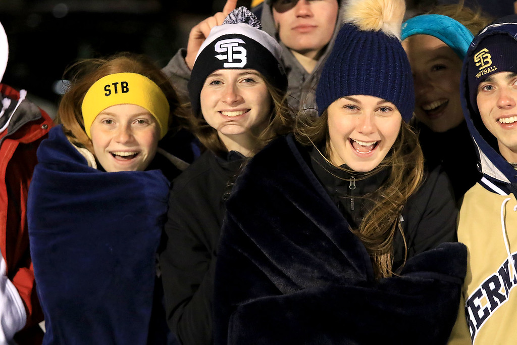 . North Middlesex Regional High School visited the Fitchburg on Wednesday night, November 21, 2018 to play St. Bernard\'s Central Catholic High School during their Thanksgiving day game. ST. B\'s seniors Lissa Hoyt, Tory Hanlon and Alyssa Thibodeau stay warm at the game. SENTINEL & ENTERPRISE/JOHN LOVE
