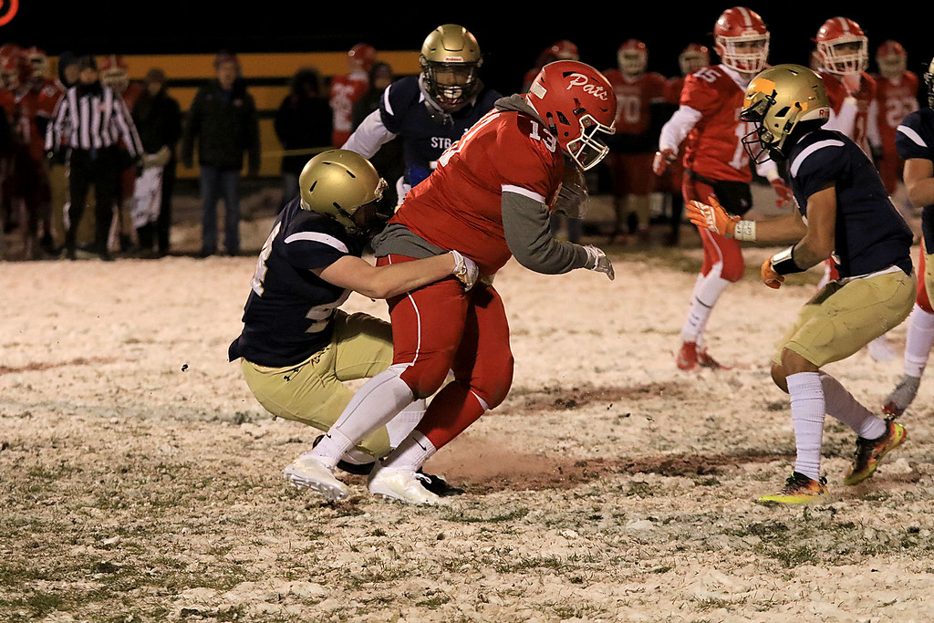 . North Middlesex Regional High School visited the Fitchburg on Wednesday night, November 21, 2018 to play St. Bernard\'s Central Catholic High School during their Thanksgiving day game. St. B\'s Jacob Banchs tackles NMRHS Abada Nkwantah. SENTINEL & ENTERPRISE/JOHN LOVE