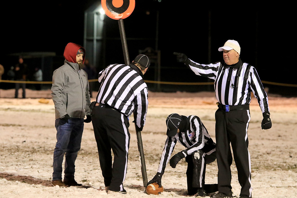 . North Middlesex Regional High School visited the Fitchburg on Wednesday night, November 21, 2018 to play St. Bernard\'s Central Catholic High School during their Thanksgiving day game. They Ref measure and ST. B\'s got the first down. SENTINEL & ENTERPRISE/JOHN LOVE