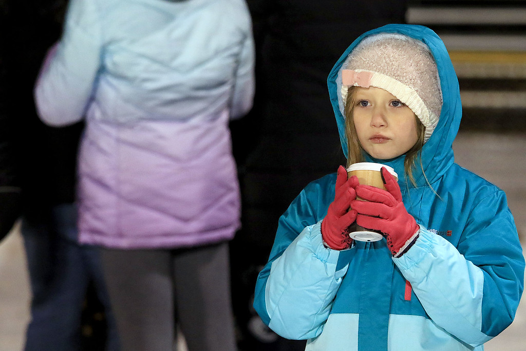 . North Middlesex Regional High School visited the Fitchburg on Wednesday night, November 21, 2018 to play St. Bernard\'s Central Catholic High School during their Thanksgiving day game. St. B\'s fan Evelyn Depatie, 7, drinks some hot chocolate as she watches the game. SENTINEL & ENTERPRISE/JOHN LOVE