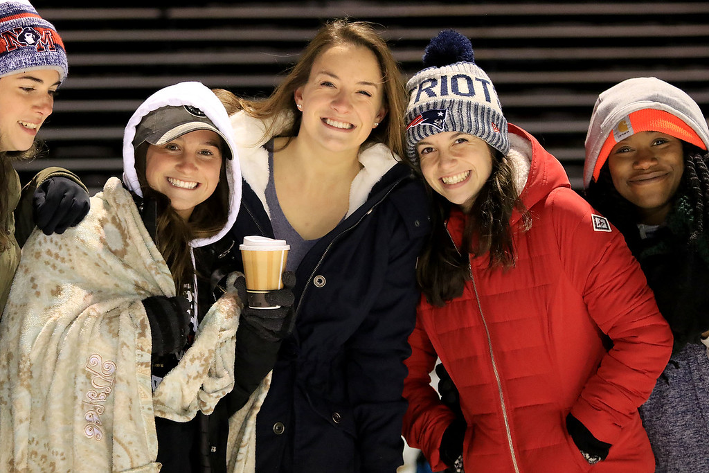 . North Middlesex Regional High School visited the Fitchburg on Wednesday night, November 21, 2018 to play St. Bernard\'s Central Catholic High School during their Thanksgiving day game. NMRHS sophomore Raelyn Callahan, senior Erin Bourgeois and senior Riley Patenande stay warm at the game. SENTINEL & ENTERPRISE/JOHN LOVE