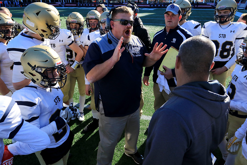 . St. Bernard�s played Pope John XXIII at Gillette Stadium in Foxborough on Saturday morning, December 1, 2018 for the Division 8 state final game. Head Coach Tom Bingham talks to his team at the two minute warning in the game. SENTINEL & ENTERPRISE/JOHN LOVE