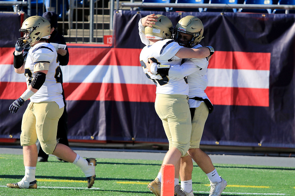 . St. Bernard�s played Pope John XXIII at Gillette Stadium in Foxborough on Saturday morning, December 1, 2018 for the Division 8 state final game. St. B\'s Jonathan Pinard celebrates some points with Domenic Cuevas in the end zone. SENTINEL & ENTERPRISE/JOHN LOVE