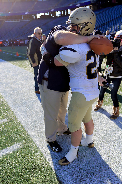 . St. Bernard�s played Pope John XXIII at Gillette Stadium in Foxborough on Saturday morning, December 1, 2018 for the Division 8 state final game. Head Coach Tom Bingham hugs Ben Goolsby as they celebrate their win. SENTINEL & ENTERPRISE/JOHN LOVE