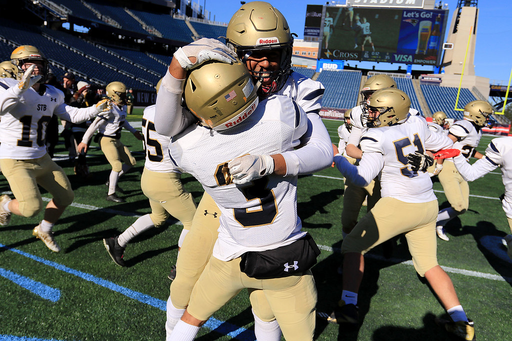 . St. Bernard�s played Pope John XXIII at Gillette Stadium in Foxborough on Saturday morning, December 1, 2018 for the Division 8 state final game. St. B\'s players Dazeen Figueroa and Walter Morales Jr. celebrate their win. SENTINEL & ENTERPRISE/JOHN LOVE