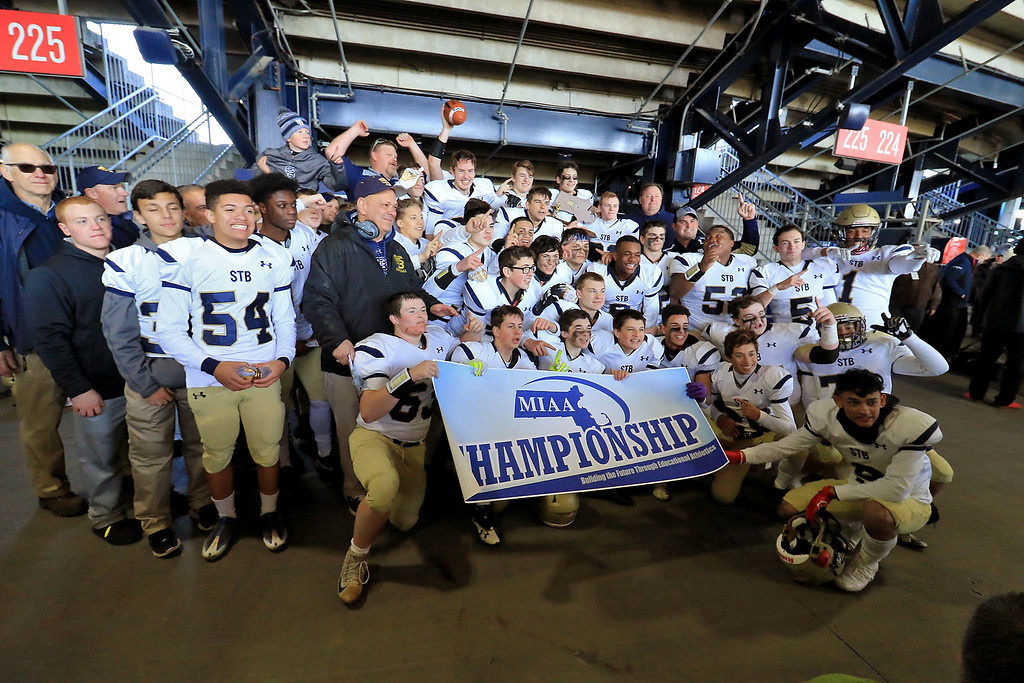 . St. Bernard�s played Pope John XXIII at Gillette Stadium in Foxborough on Saturday morning, December 1, 2018 for the Division 8 state final game. The team and coaches pose for a picture. SENTINEL & ENTERPRISE/JOHN LOVE