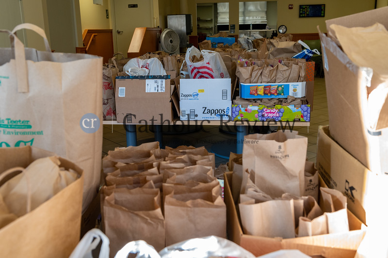 Some 1,100 lunches prepared by St. Casimir Catholic Church, Canton, parishioners and neighborhood residents were delivered Jan. 12 to the St. Vincent de Paul Bean and Bread Center on S. Bond St. (Kevin J. Parks/CR Staff)