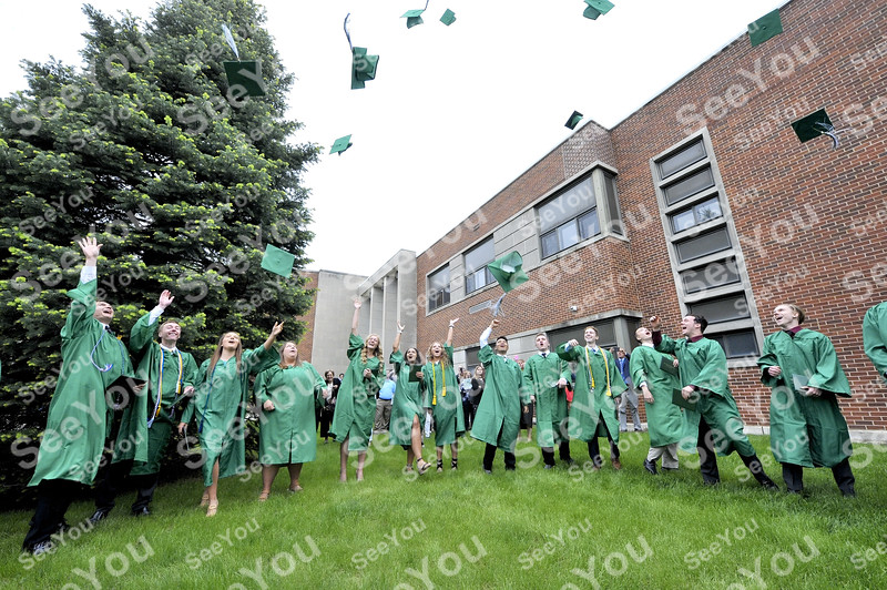-Messenger photo by Hans Madsen<br /> <br /> Some of the St. Edmond Catholic School Class of 2019 toss their caps into the air Sunday afternoon following commencement.