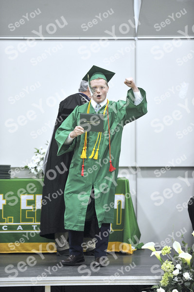 -Messenger photo by Hans Madsen<br /> <br /> St. Edmond Catholic School graduate Jack MeVoy celebrates getting his diploma Sunday afternoon during commencement.