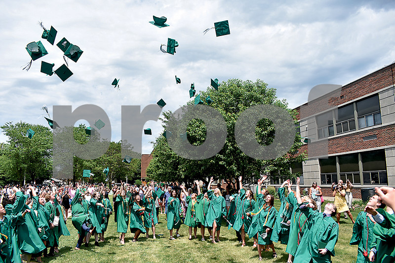 -Messenger photo by Elijah Decious<br /> <br /> The St. Edmond class of 2020 tosses their caps with reckless abandon as their focus shifts to the bright future ahead of them.