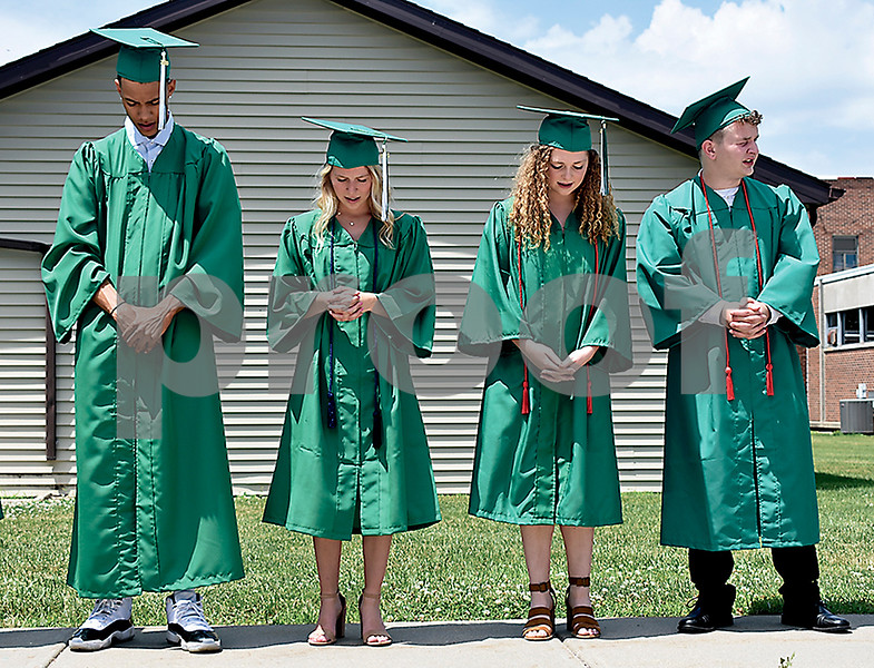 -Messenger photo by Elijah Decious<br /> <br /> From left to right: Jerris Duncan, Taryn Feser, Claire Fleming and Cooper Fleming say The Lord's Prayer before St. Edmond High School's graduation commencement Sunday.