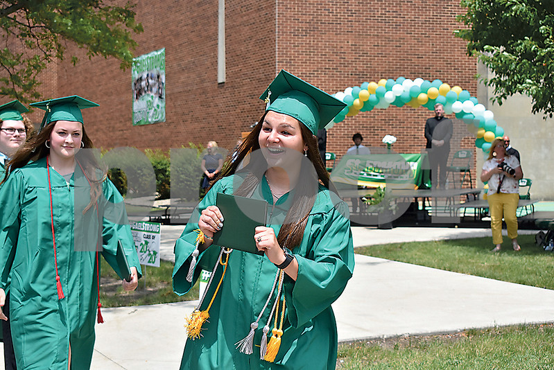 -Messenger photo by Elijah Decious<br /> <br /> St. Edmond graduate Jaedyn Condon walks away with excitement and her diploma in hand after commencement Sunday.