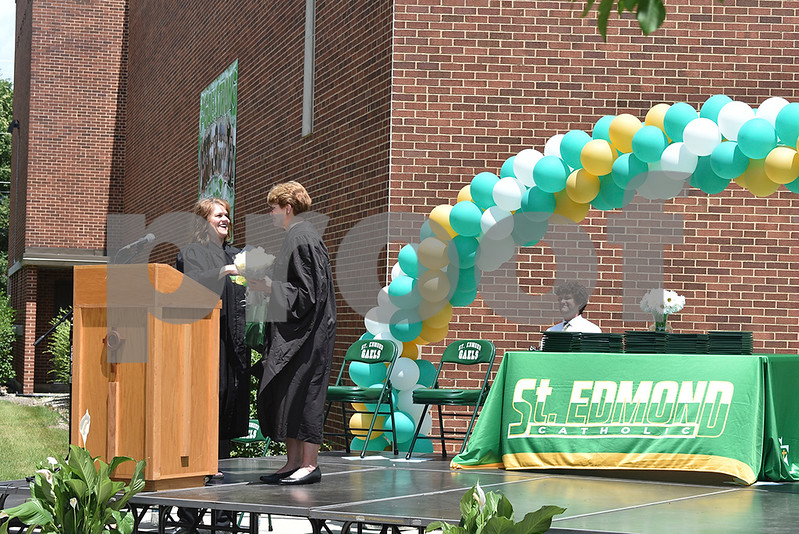 -Messenger photo by Elijah Decious<br /> <br /> St. Edmond Catholic School President Mary Gibbs thanks retiring principal Linda Mitchell for 45 years of service in a bittersweet moment at commencement Sunday.