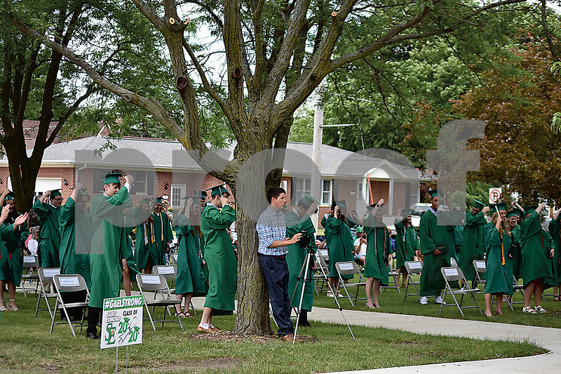 -Messenger photo by Elijah Decious<br /> <br /> The St. Edmond class of 2020 moves their tassel after commencement Sunday.
