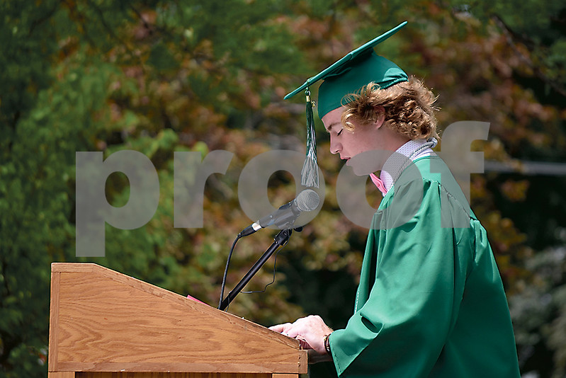 -Messenger photo by Elijah Decious<br /> <br /> Jed Tracy delivers a speech to his fellow class of 2020 at St. Edmond's graduation ceremony Sunday.