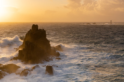 Lands End at sunset on a stormy evening, Cornwall, UK