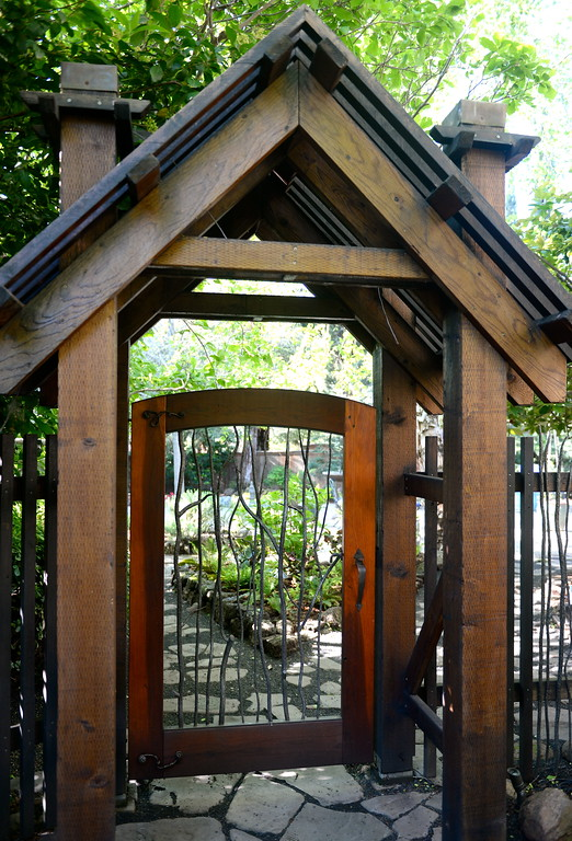 . A custom gated entrance into the back yard is seen during a tour of the garden at Ruth Guzley\'s residence in Chico, Calif. Friday April 14, 2017. This is one of the gardens that will be featured during the St. John Episcopal Church Garden Tour.  (Bill Husa -- Enterprise-Record)