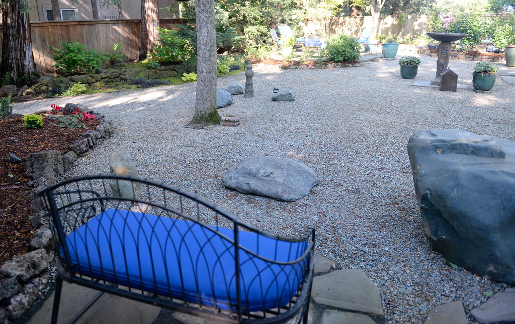 . Many sitting areas can be found in the back yard seen during a tour of the garden at Ruth Guzley\'s residence in Chico, Calif. Friday April 14, 2017. This is one of the gardens that will be featured during the St. John Episcopal Church Garden Tour.  (Bill Husa -- Enterprise-Record)