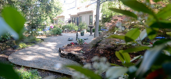 Gravel walkways area seen winding through back yard sitting areas during a tour of the garden at Ruth Guzley's residence in Chico, Calif. Friday April 14, 2017. This is one of the gardens that will be featured during the St. John Episcopal Church Garden Tour.  (Bill Husa -- Enterprise-Record)