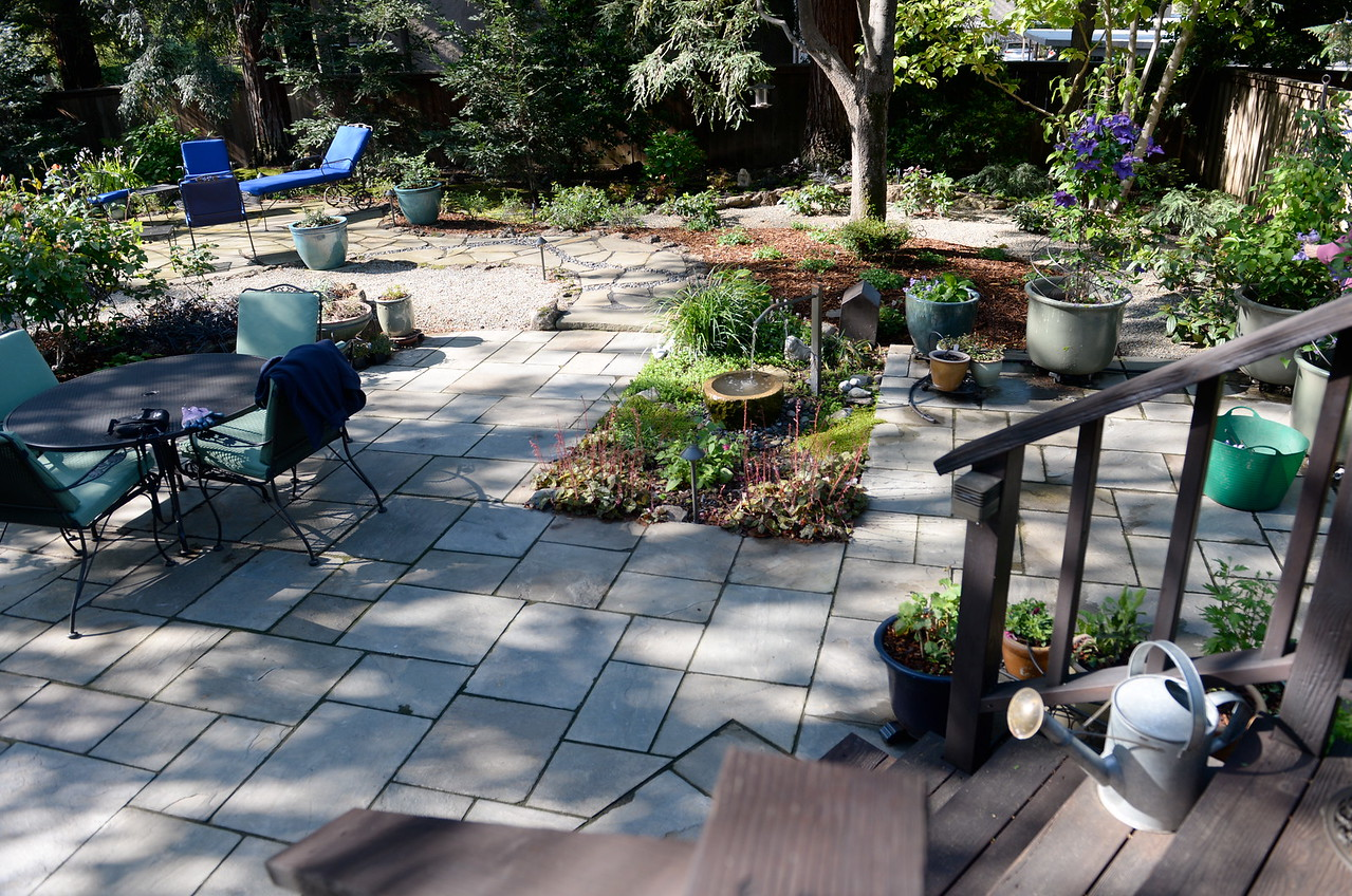Many sitting areas can be found in the back yard seen during a tour of the garden at Ruth Guzley's residence in Chico, Calif. Friday April 14, 2017. This is one of the gardens that will be featured during the St. John Episcopal Church Garden Tour.  (Bill Husa -- Enterprise-Record)