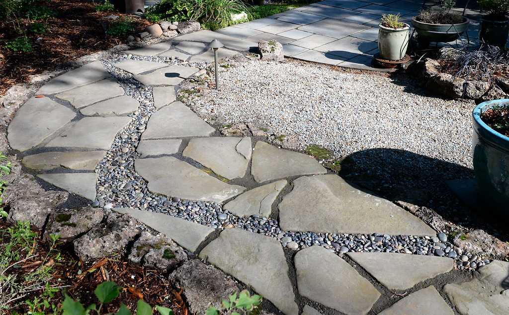 . Stone and gravel walkways are seen during a tour of the garden at Ruth Guzley\'s residence in Chico, Calif. Friday April 14, 2017. This is one of the gardens that will be featured during the St. John Episcopal Church Garden Tour.  (Bill Husa -- Enterprise-Record)