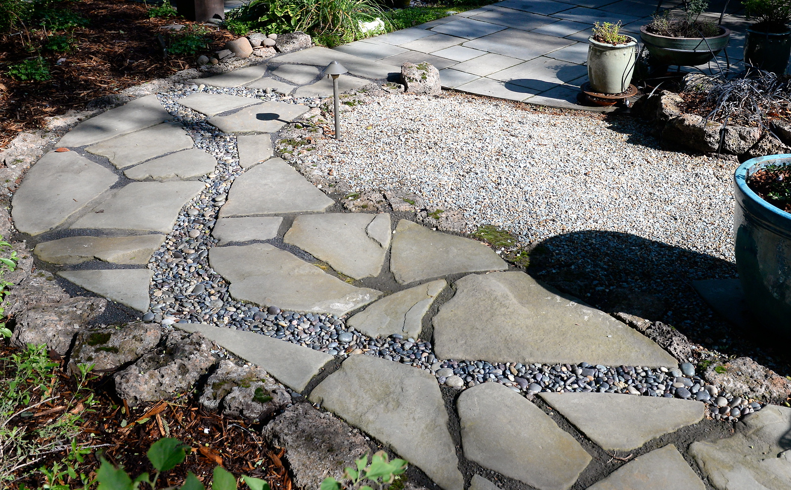 Stone and gravel walkways are seen during a tour of the garden at Ruth Guzley's residence in Chico, Calif. Friday April 14, 2017. This is one of the gardens that will be featured during the St. John Episcopal Church Garden Tour.  (Bill Husa -- Enterprise-Record)