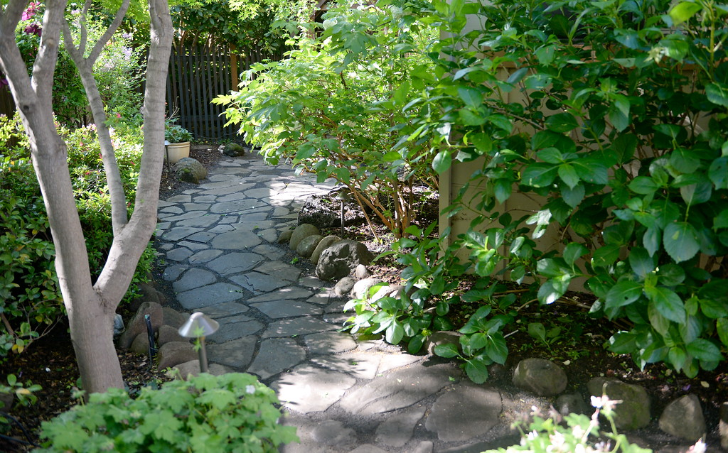 . Paths of stepping stones are seen during a tour of the garden at Ruth Guzley\'s residence in Chico, Calif. Friday April 14, 2017. This is one of the gardens that will be featured during the St. John Episcopal Church Garden Tour.  (Bill Husa -- Enterprise-Record)