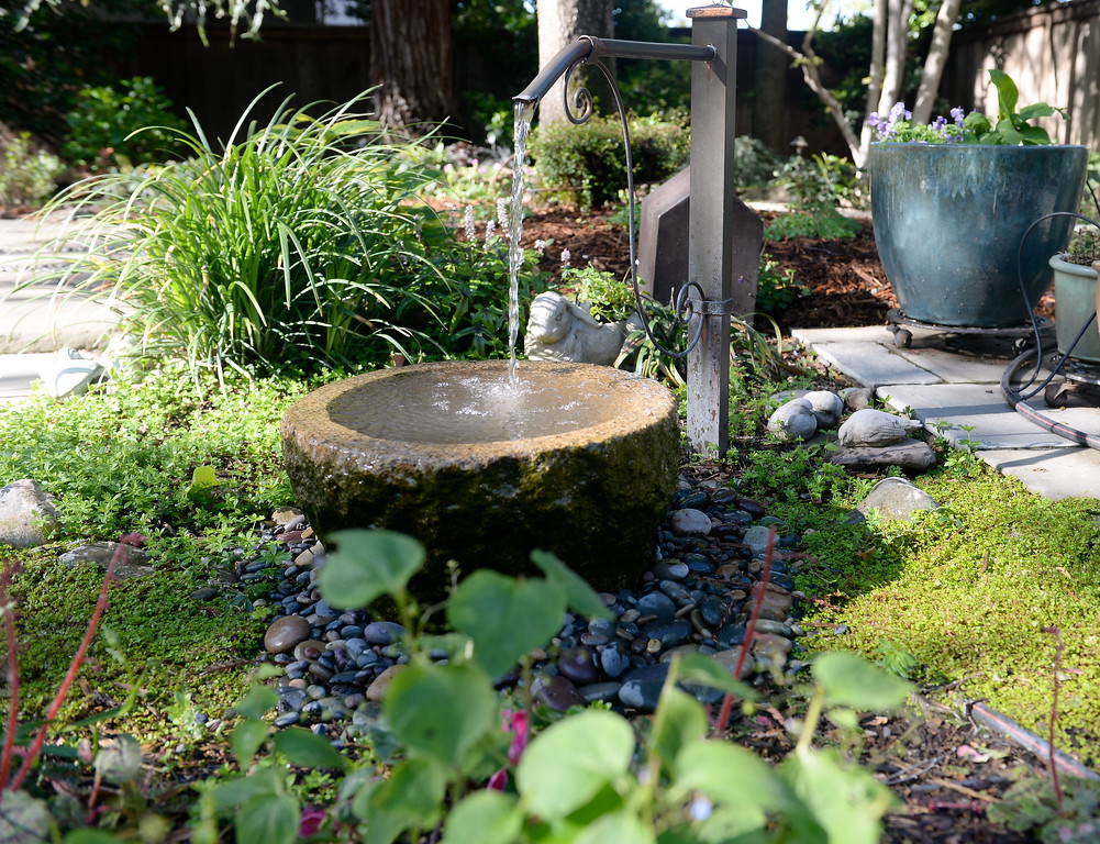 . A fountain is seen during a tour of the garden at Ruth Guzley\'s residence in Chico, Calif. Friday April 14, 2017. This is one of the gardens that will be featured during the St. John Episcopal Church Garden Tour.  (Bill Husa -- Enterprise-Record)