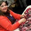 The Rev. Karen Zutz Rendall, chaplain at Homme Home for the Aging in Wittenberg, WI, tying a fleece blanket for homeless students in the Green Bay School District. Members of the ECSW made 409 blankets over the two days of the assembly.