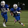 Leominster High School football played Saint John's on Friday night at Doyle Field in Leominster. LHS's #82 Darian O'Brien  leads the way for #34 Bryant Cordero. SENTINEL & ENTERPRISE/JOHN LOVE