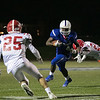 Leominster High School football played Saint John's on Friday night at Doyle Field in Leominster. SJHS's #20 Sam Pedone just misses LHS's #4 Vashon Dixon. SENTINEL & ENTERPRISE/JOHN LOVE