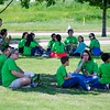 A group of fourth graders and their parent volunteers sit in the shade for lunch outside the VA Hospital in Fort Worth. (Photo by Adrean Indolos / NTC)