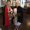 Wearing the original traditional nurses' uniform — a navy blue cape with red lining highlighted by turning the back over one shoulder and a nurses cap — are Christine Clarke Giarrusso, left, of Pelham, N.H., and Leslie McCartin Morin of Lowell