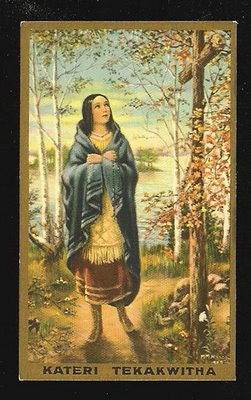 "This Holy Card is a lithograph copy of Mother Nealis' original work titled ""Blessed Kateri Tekakwitha"".  The original was painted in 1927 (oil on canvas 15""x18"") and it shows the image of young Kateri Tekakwitha (Gah-deh-lee Deh-gah-quee-tah) standing before a cross. She is dressed in traditional Native American long dress made of deerskin with a long blouse and a blue blanket over her shoulders. At the bottom right corner are the artist's initials, ""M.M.N., R.S.C.J."" (Margaret M. Nealis) The original oil painting is now on display at St. Xavier, Kateri Tekakwitha Shrine, Kahnawake Canada.  (ref.  <a href=""http://www.aashpresidentmer.com"">http://www.aashpresidentmer.com</a>)"