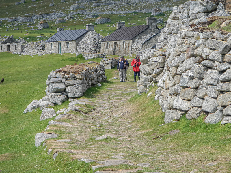 Walkers in village bay
