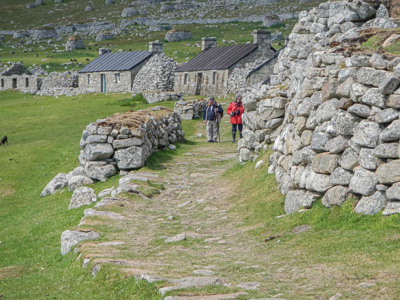 Walkers in village bay