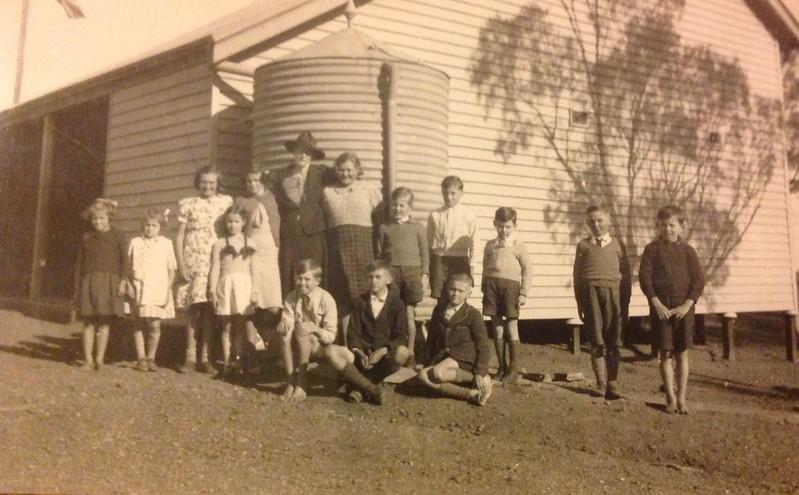 St Kitts school  ... date of photo c1940.  From left : Betty Noack, Eileen Noack, Phylis Noack, Margaret Bywater, Lorna Noack, Mrs Bywater, Colin Doecke (kneeling), Erna Schmit, Wilfred Noack (kneeling), Rodney  Bywater, Arnold Noack, David Noack (kneeling), Trevor Waechter, John Schmidt, Gilbert Doecke,