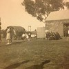 School picnic at the school master's residence, note the straw roofed barn in the back ground