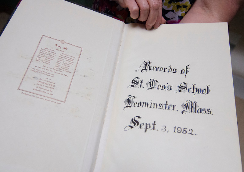 An old record book at St. Leo School's in Leominster, which is celebrating it's 90th anniversary. SENTINEL & ENTERPRISE / Ashley Green