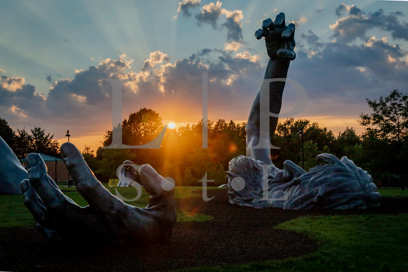 The Awakening, by J. Seward Johnson at sunset