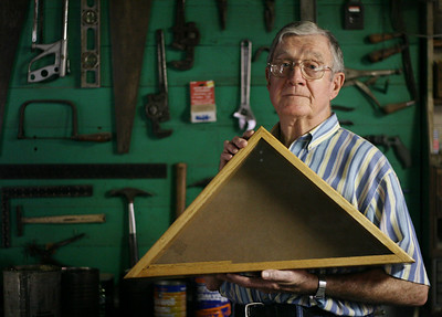 ELISA PETERSEN / Courier & Press World War II veteran Bill Kincheloe shows the wooden flag cases he makes in his workroom in Wadesville, Ind. on Thursday, Sept. 6, 2007. He gives the cases to families of soldiers killed in Iraq.