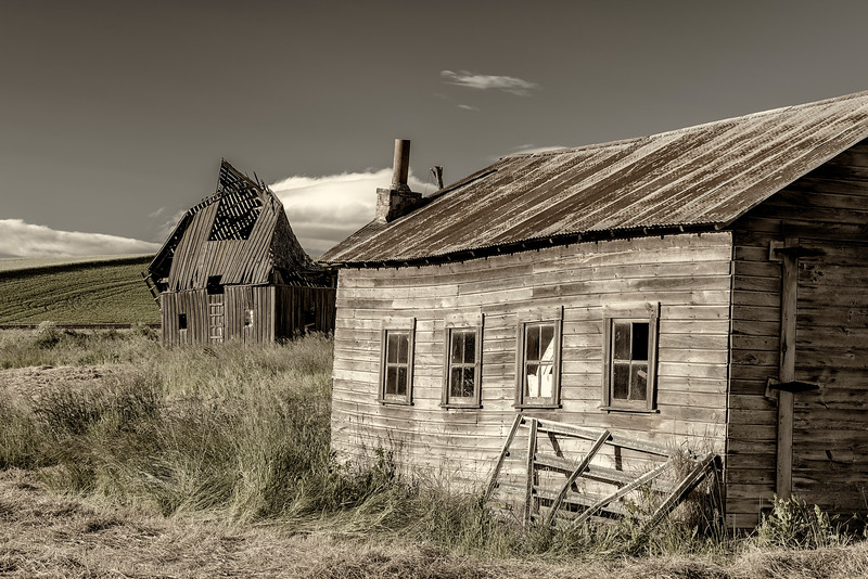 Old weathered shed and crumbling barn