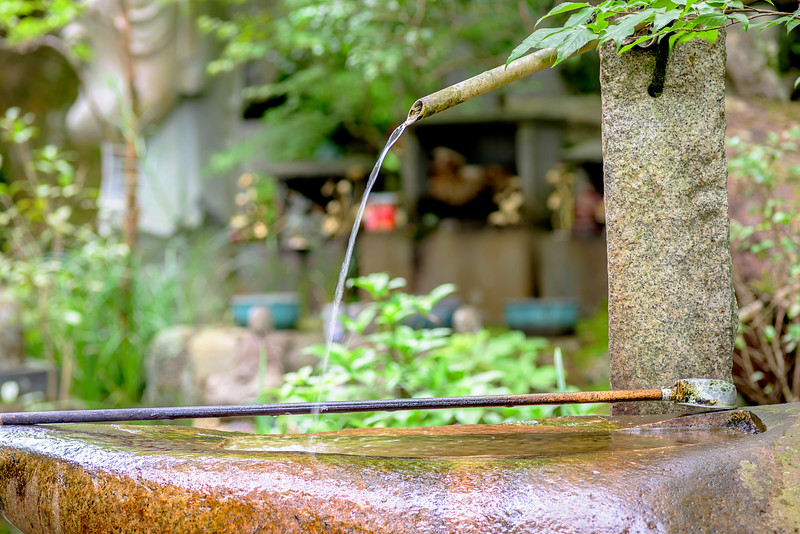 Spout of water at a temple in Japan with dipper