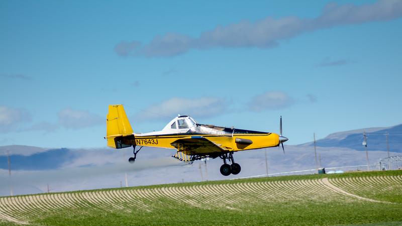Idaho Crop Duster south of Caldwell sprays a field
