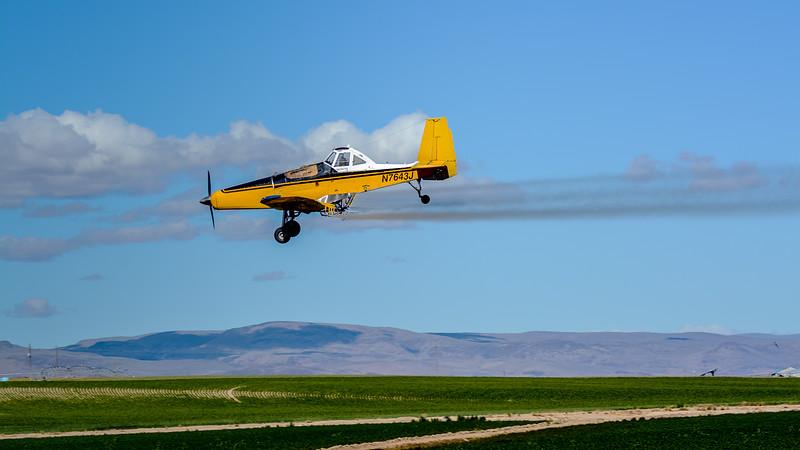 Crop Duster spraying crops near Caldwell Idaho
