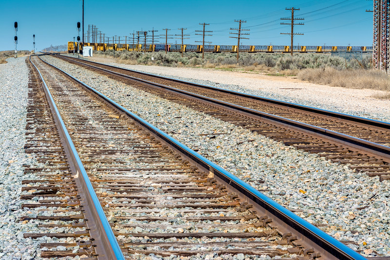 Railroad tracks lead to a parked train