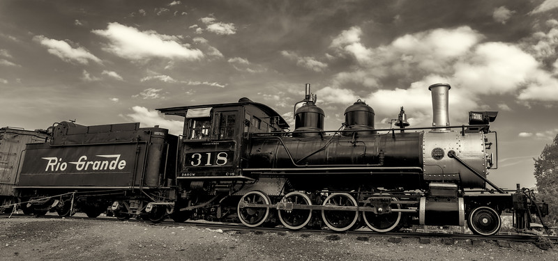 Black and White Antique Train with Cloudy Sky