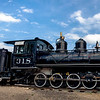 Antique Train with Blue Sky and Clouds