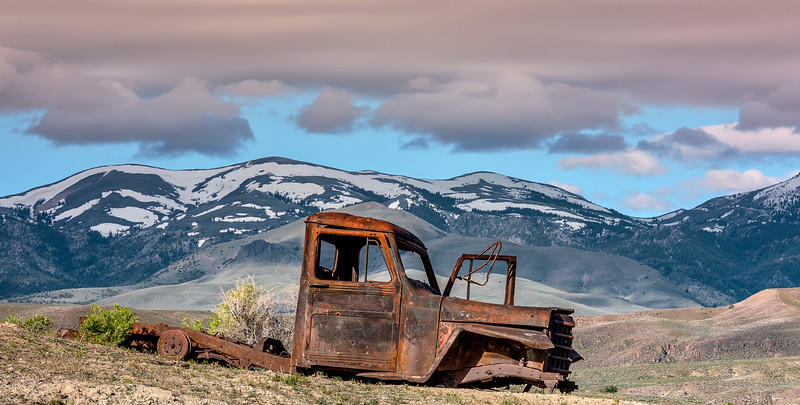 Truck in the Desert with Owyhee Mountains